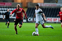 Monday 20 January 2014<br /> Pictured:( L-R ) Luke Coulson plays catchup as  James Loveridge crosses the ball for Swansea<br /> Re: Swansea City U21 v Cardiff City U21 at the Liberty Stadium, Swansea Wales