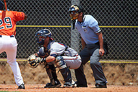 GCL Braves catcher Collin Yelich (62) and umpire Michael Boulianne during a game against the GCL Astros on July 23, 2015 at the Osceola County Stadium Complex in Kissimmee, Florida.  GCL Braves defeated GCL Astros 4-2.  (Mike Janes/Four Seam Images)
