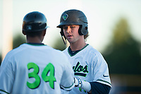 Hillsboro Hops shortstop LT Tolbert (11) talks to first base coach Jaime Del Valle (34) during a Northwest League game against the Salem-Keizer Volcanoes at Ron Tonkin Field on September 1, 2018 in Hillsboro, Oregon. The Salem-Keizer Volcanoes defeated the Hillsboro Hops by a score of 3-1. (Zachary Lucy/Four Seam Images)