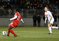 BOYDS, MARYLAND - April 06, 2013:  Jasmyne Spencer (20) of The Washington Spirit scores the third goal against  the University of Virginia women's soccer team in a NWSL (National Women's Soccer League) pre season exhibition game at Maryland Soccerplex in Boyds, Maryland on April 06. Virginia won 6-3.