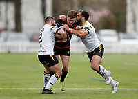 28th March 2021; Rosslyn Park, London, England; Betfred Challenge Cup, Rugby League, London Broncos versus York City Knights; Jacob Jones of London Broncos tackled by Jason Bass and Ryan Atkins of York City Knights