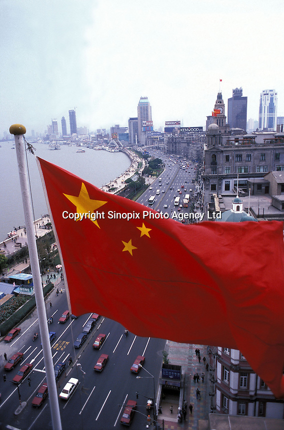 A Chinese national flag over looking the bund of Shanghai, China.