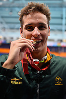 Chad le Clos of RSA celebrates victory in 100 meter butterfly final during Commonwealth Games Swimming, Monday, July 28, 2014 in Glasgow, United Kingdom. (Mo Khursheed/TFV Media via AP Images)