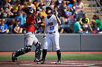 West Virginia Black Bears Cory Wood (27) flips his bat as catcher Dustin Skelton throws the ball back to the pitcher during a NY-Penn League game against the Batavia Muckdogs on August 29, 2019 at Monongalia County Ballpark in Morgantown, New York.  West Virginia defeated Batavia 5-4 in ten innings.  (Mike Janes/Four Seam Images)