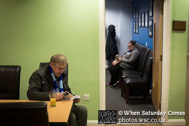Bishop Auckland 3 West Auckland Town 1, 22/01/2016. Heritage Park, Northern League Division One. A man with a drink in the bar area and a woman sitting in the director's lounge in the grandstand before Bishop Auckland host West Auckland Town in a Northern League division one match at Heritage Park. Bishop Auckland were winners of the Amateur Cup 10 times between 1895 and 1957 whilst their opponents won the Sir Thomas Lipton Trophy, regarded as the first world club tournament, in 1909 and 1911.  Bishop Auckland won this fixture 3-1, watched by a crowd of 422 at the ground they moved into in 2010. Photo by Colin McPherson.