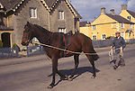 Brian Higham long serving Stud Groom at The Duke of Beaufort Badminton House estate. Morning training session in estate village. 1995