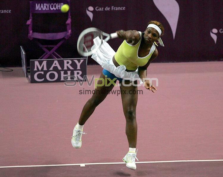 PIX: Tennis. WTA Open Gaz de France/Paris Open, Stade Pierre de Coubertin, Paris, 7-14th February 2005...COPYRIGHT PICTURE>> SIMON WILKINSON>>0870 092 0092>>..Serena Williams (USA) takes on Stephanie Cohen-Aloro..