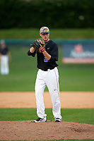 Niagara University Purple Eagles relief pitcher Matt McCuen (29) gets ready to deliver a pitch during a game against the Ohio State Buckeyes on February 20, 2016 at Holman Stadium at Historic Dodgertown in Vero Beach, Florida.  Ohio State defeated Niagara 10-7.  (Mike Janes/Four Seam Images)