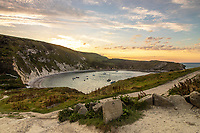 BNPS.co.uk (01202) 558833<br /> Pic: RachelBaker/BNPS<br /> <br /> Lulworth Cove in Dorset<br /> <br /> Officers searching for a diver who went missing off the south coast of England have found a body.<br /> <br /> Carvalho Ildelindo da Silveira, aged in his 60s, was last seen diving off the coast of Lulworth Cove at 4.15pm on Saturday.<br /> <br /> He was reported missing four hours later and major searches having since taken place involving police, lifeboat, coastguard and a search and rescue helicopter.<br /> <br /> At around 3.05pm yesterday (Tues), divers from Devon & Cornwall Police, with assistance from the Dorset Police Marine Section, located a man's body in Lulworth Bay.