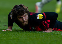 13th April 2021; The John Smiths Stadium, Huddersfield, Yorkshire, England; English Football League Championship Football, Huddersfield Town versus Bournemouth; Ben Pearson of Bournemouth eats grass after being upended