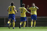 Billy Healey of Wingate & Finchley scores the third goal for his team and celebrates with his team mates during Hornchurch vs Wingate & Finchley, Pitching In Isthmian League Premier Division Football at Hornchurch Stadium on 6th October 2020