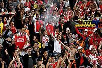 BOGOTÁ - COLOMBIA, 02-09-2018: Hinchas de Independiente Santa Fe (COL), celebran la clasificación de su equipo a la siguiente fase luego de vencer a Millonarios (COL) por definiciones desde el punto penal, durante partido de vuelta entre Millonarios (COL) y el Independiente Santa Fe (COL), de los octavos de final, llave A por la Copa Conmebol Sudamericana 2018, en el estadio Nemesio Camacho El Campin, de la ciudad de Bogotá. / Fans of Independiente Santa Fe (COL), celebrate the classification to the next phase of their team after beating to Millonarios (COL) by definitions from the penal point, during a match of the second leg between Millonarios (COL) and Independiente Santa Fe (COL), of the eighth finals, key A for the Conmebol Sudamericana Cup 2018 in the Nemesio Camacho El Campin stadium in Bogota city. Photo: VizzorImage / Luis Ramírez / Staff.