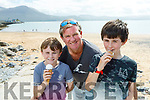 Rory and Zach Kearney enjoying their ice cream with their dad Stephen on Fenit Beach on Tuesday,
