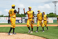 Jacksonville Suns pitcher Juancito Martinez (28) fist bumps Kenny Wilson (3), Matt Juengel (15) and Carlos Lopez (7) after the 20th Annual Rickwood Classic Game against the Birmingham Barons on May 27, 2015 at Rickwood Field in Birmingham, Alabama.  Jacksonville defeated Birmingham by the score of 8-2 at the countries oldest ballpark, Rickwood opened in 1910 and has been most notably the home of the Birmingham Barons of the Southern League and Birmingham Black Barons of the Negro League.  (Mike Janes/Four Seam Images)