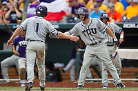 TCU Horned Frogs second baseman Garrett Crain (34) greets teammate Cody Jones (1) after he scored against the LSU Tigers in the NCAA College World Series on June 14, 2015 at TD Ameritrade Park in Omaha, Nebraska. TCU defeated LSU 10-3. (Andrew Woolley/Four Seam Images)