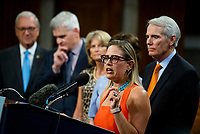United States Senator Kyrsten Sinema (Democrat of Arizona) makes remarks after the vote on the motion to invoke cloture to proceed to the consideration of H.R. 3684, the INVEST in America Act on Capitol Hill in Washington, DC on Wednesday, July 28, 2021. The vote to begin discussion of the bipartisan infrastructure bill agreed to by the White House, was 67 to 32. If passed, the bill would invest close to $1 trillion in roads, bridges, ports and other infrastructure without a major tax increase.<br /> Credit: Rod Lamkey / CNP / MediaPunch