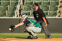 Catcher Tommy Joseph #33 of the Augusta GreenJackets gives his pitcher a target as home plate umpire Ryan Karle looks on during a South Atlantic League game between the Augusta GreenJackets and the Kannapolis Intimidators at Fieldcrest Cannon Stadium June 24, 2010, in Kannapolis, North Carolina.  Photo by Brian Westerholt / Four Seam Images