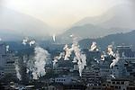 Smoke of hot spring, Onsen, comes out all over the place in Beppu town.<br /> <br /> Une fumée de source chaude s'installe dans la ville de Beppu. Japon.