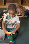 Education Preschool Phase-in First Days of School 3-4 year olds boy building with plastic building blocks