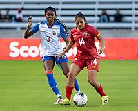 HOUSTON, TX - FEBRUARY 3: Maryorie Perez #14 of Panama and Chelsea Surpris #3 of Haiti vie for the ball during a game between Panama and Haiti at BBVA Stadium on February 3, 2020 in Houston, Texas.