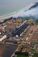 aerial photograph smoke emitted from stacks to generate electrical power at a plant on the Gulf Coast in northeastern Mexico