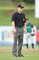 Umpire Jonathan Bailey handles the calls on the bases during a South Atlantic League game between the Augusta GreenJackets and the Kannapolis Intimidators at Fieldcrest Cannon Stadium June 24, 2010, in Kannapolis, North Carolina.  Photo by Brian Westerholt / Four Seam Images
