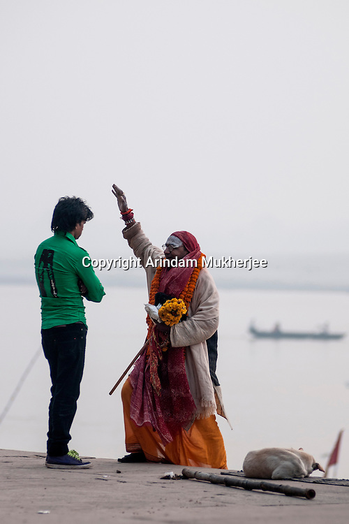A holy man blesses a man in one of the ghats in Varanasi, Uttar Pradesh, India.
