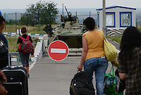 People who just crossed Ukrainian-Russian border at Izvarine check point - one of border crossings controlled by Luhansk Peoples Republic. According to rebels around 5 thousand people leave Ukraine every day through Izvarine border crossing.