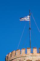 The White Tower. Greek flag. Thessaloniki, Macedonia, Greece