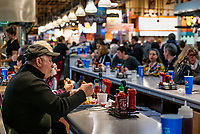 Diners eating lunch at the Reading Terminal Market in Philadelphia.