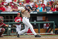 Virginia Cavaliers first baseman Pavin Smith (10) swings the bat against the Arkansas Razorbacks in Game 1 of the NCAA College World Series on June 13, 2015 at TD Ameritrade Park in Omaha, Nebraska. Virginia defeated Arkansas 5-3. (Andrew Woolley/Four Seam Images)
