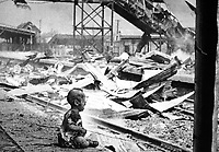 This terrified baby was almost the only human being left alive in Shanghai's South Station after brutal Japanese bombing.  China, August 28, 1937.  H.S. Wong. (OWI)<br /> NARA FILE #:  208-AA-132N-2<br /> WAR & CONFLICT BOOK #:  1131