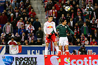 Harrison, NJ - Tuesday April 10, 2018: Florian Valot, Carlos Cisneros during leg two of a  CONCACAF Champions League semi-final match between the New York Red Bulls and C. D. Guadalajara at Red Bull Arena. C. D. Guadalajara defeated the New York Red Bulls 0-0 (1-0 on aggregate).