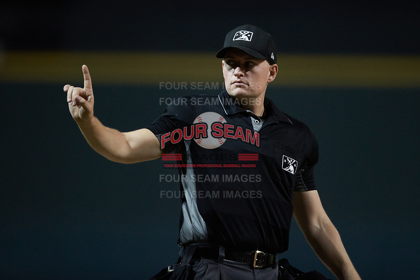 Home plate umpire Sean Cassidy during the game between the Asheville Tourists and the Winston-Salem Dash at Truist Stadium on September 17, 2021 in Winston-Salem, North Carolina. (Brian Westerholt/Four Seam Images)