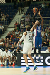 Real Madrid´s Ioannis Bourousis and Anadolu Efes´s Stephane Lasme during 2014-15 Euroleague Basketball match between Real Madrid and Anadolu Efes at Palacio de los Deportes stadium in Madrid, Spain. December 18, 2014. (ALTERPHOTOS/Luis Fernandez)