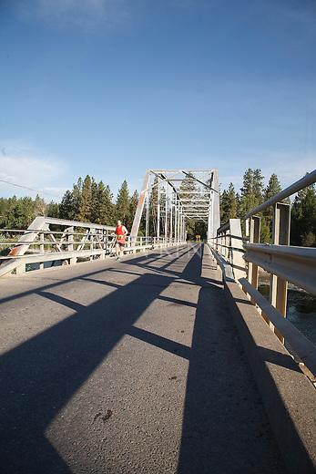 runner in the missoula montana marathon crossing the maclay bridge over the bitterroot rive in missoula, montana