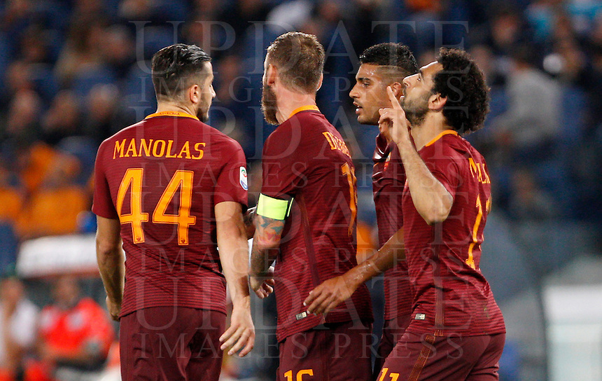 Calcio, Serie A: Roma vs Palermo. Roma, stadio Olimpico, 23 ottobre 2016.<br /> Roma's Mohamed Salah, right, celebrates with teammates, from left, Kostas Manolas, Daniele De Rossi and Emerson Palmieri, after scoring during the Italian Serie A football match between Roma and Palermo at Rome's Olympic stadium, 23 October 2016. Roma won 4-1.<br /> UPDATE IMAGES PRESS/Riccardo De Luca