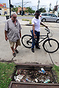 Residents of Marigny neighborhood in New Orleans get help cleaning out clogged catch basins ahead of Tropical Storm Barry, which is expected to make landfall as a Category 1 hurricane on Sat., in New Orleans, Fri., July, 12, 2019.