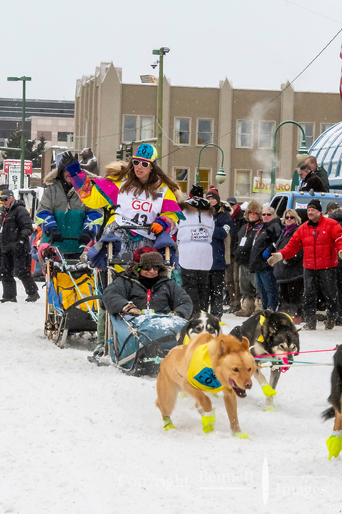 Monica Zappa and team leave the ceremonial start line with an Iditarider and handler at 4th Avenue and D street in downtown Anchorage, Alaska on Saturday March 7th during the 2020 Iditarod race. Photo copyright by Cathy Hart Photography.com