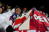 Japanese fans wave a large Japan flag made of of several separate pieces tied together with string during Japan's match against Denmark  at the Royal Bafokeng Stadium at the 2010 World Cup first round match in Rustenberg, South Africa on Thursday, June 24, 2010.