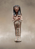 Ancient Egyptian shabtis doll, lwood, New Kingdom, 18th Dynasty, (1538-1040 BC), Deir el Medina. Egyptian Museum, Turin. <br /> <br /> shabti figures began to occur in Middle Kingdom tombs with a twofold nature: on <br /> the one hand, they were meant to be images of their owners, representatives of the deceased in the realm of the Lord of Eternity. <br /> On the other hand, they were also considered to be servants of the deceased, taking the role of the servant statues. The complex <br /> nature of the shabti figure as a substitute of both the owner and his or her servants remains unaltered during the New Kingdom