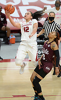 Arkansas guard Destiny Slocum (12) reaches to score Thursday, Feb. 11, 2021, past Mississippi State guard Jamya Mingo-Young (0) during the first half of play in Bud Walton Arena. Visit nwaonline.com/210212Daily/ for today's photo gallery. <br /> (NWA Democrat-Gazette/Andy Shupe)