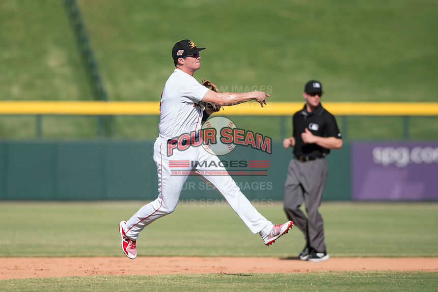 Mesa Solar Sox third baseman Bobby Dalbec (11), of the Boston Red Sox organization, throws to first base in front of field umpire Blake Carnahan during an Arizona Fall League game against the Peoria Javelinas at Sloan Park on October 24, 2018 in Mesa, Arizona. Mesa defeated Peoria 4-3. (Zachary Lucy/Four Seam Images)