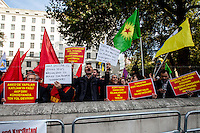 London, 11/10/2015. Today, several thousand Turkish and Kurdish people united held a demonstration outside N.10 Downing Street, and subsequently marched to the BBC HQ in Portland place. The demonstration was called against the bombing attack at a peace protest in Ankara on the 10 October 2015 were more than 100 innocent people were killed and more than 500 people were seriously injured. From the organiser Facebook page: <<[…] We demand peace. We are gathering in London for a solidarity protest with those killed and those who stand for peace in Turkey. End state terror now! Unite against State terror!>>.<br /> <br /> For more information please click here: http://on.fb.me/1hzJH9N
