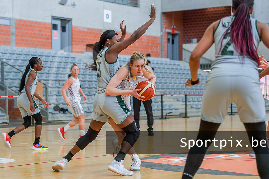 Becky Massey (25) of Belgium and Nicole Elabosi (33) of Nigeria pictured during a basketball game between the national teams of Belgium , called the Belgian Cats , and Nigeria on Sunday 30 th of May 2021 in Kortrijk , Belgium . PHOTO SPORTPIX.BE | SPP | STIJN AUDOOREN