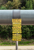 Trans Alaska oil pipeline with milage post sign.