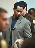 Convicted sniper John Allen Muhammad is escorted into the court as the jury reconvenes after deliberating his fate for almost four hours at the Virginia Beach Circuit Court in Virginia Beach, Virginia on November 21, 2003. The jury in the case will decide whether Muhammad will be sentenced to life in prison or death. <br /> Credit: Martin Smith-Rodden - Pool via CNP