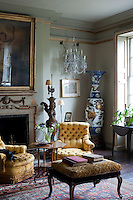 Chandeliers have been re-hung along the sides of the living room to create a more unusual lighting scheme