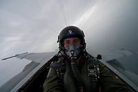 120225-N-DR144-354 ARABIAN GULF (Feb. 25, 2012) Mass Communication Specialist 2nd Class James R. Evans, assigned to Navy Public Affairs Support Element West takes a self portrait in the back seat of an F/A-18F Super Hornet flown by Lt. Michael Loringer during a photo exercise flown from the Nimitz-class aircraft carrier USS Carl Vinson (CVN 70). Carl Vinson and Carrier Air Wing (CVW) 17 are deployed to the U.S. 5th Fleet area of responsibility.  (U.S. Navy photo by Mass Communication Specialist 2nd Class James R. Evans/Released)
