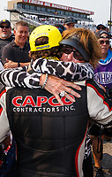 Sep 4, 2017; Clermont, IN, USA; NHRA top fuel driver Steve Torrence celebrates with mother Kay Torrence after winning the US Nationals at Lucas Oil Raceway. Mandatory Credit: Mark J. Rebilas-USA TODAY Sports